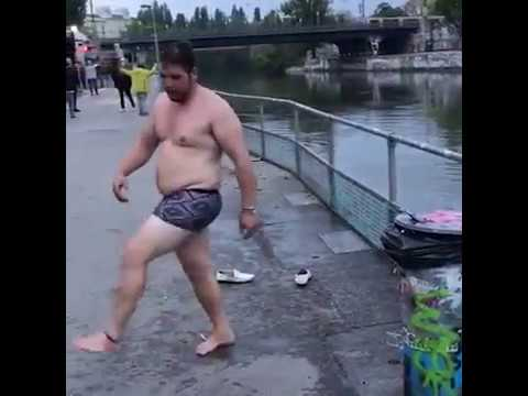 Drunk Guy Tries To Jump Over Railing Into River Below